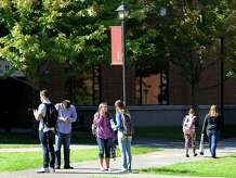 Students are seen on the grounds of Western Connecticut State University after several buildings at the UniversityâÄôs midtown  campus were evacuated Friday afternoon after the schoolâÄôs webmaster received an email stating that bombs were planted in four buildings on midtown campus.   Paul Steinmetz, a spokesperson for the university, the university immediately evacuated University Hall, Haas Library, Newbury Hall, and the Student Center.