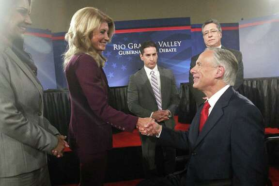 State Sen. Wendy Davis greets Texas Attorney General Greg Abbott after participating in the Rio Grande Valley gubernatorial debate in Edinburg. It was the first of two scheduled debates between the pair.