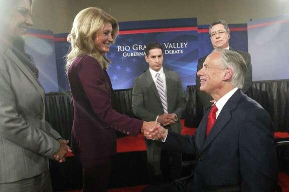 State Sen. Wendy Davis greets Texas Attorney General Greg Abbott after participating in the Rio Grande Valley gubernatorial debate in Edinburg. It was the first of two scheduled debates between the pair.