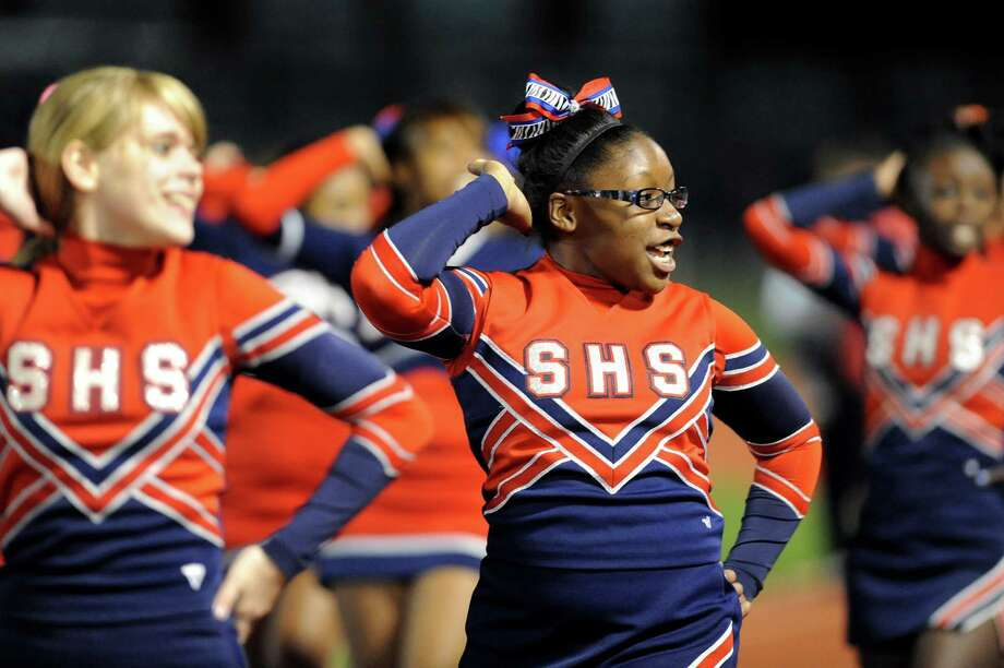Schenectady cheerleader Shayla Beauford, 16, center, cheers for her team during their football game against Shaker on Friday, Sept. 19, 2014, at Schenectady High in Schenectady, N.Y. (Cindy Schultz / Times Union) Photo: Cindy Schultz / 00028670A