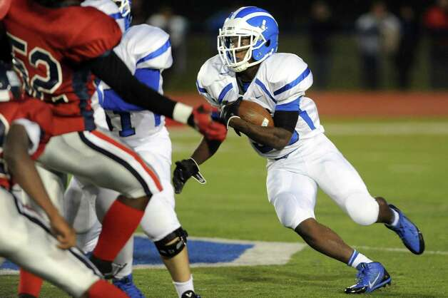 Shaker's Andrew Bolton, right, looks for an opening as he runs the ball during their football game against Schenectady on Friday, Sept. 19, 2014, at Schenectady High in Schenectady, N.Y. (Cindy Schultz / Times Union) Photo: Cindy Schultz / 00028670A