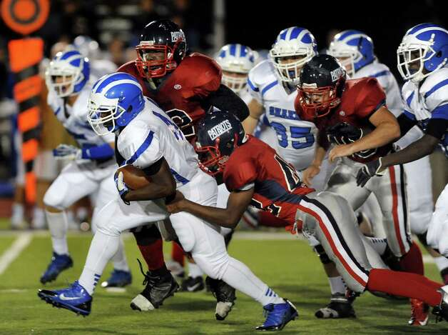 Shaker's Kwasi Addo, left, pushes for a first down during their football game against Schenectady on Friday, Sept. 19, 2014, at Schenectady High in Schenectady, N.Y. (Cindy Schultz / Times Union) Photo: Cindy Schultz / 00028670A
