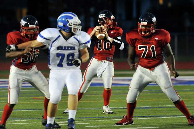 Schenectady's quarterback Brandon Gwinner, center, looks to pass during their football game against Shaker on Friday, Sept. 19, 2014, at Schenectady High in Schenectady, N.Y. (Cindy Schultz / Times Union) Photo: Cindy Schultz / 00028670A