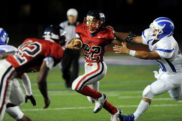 Schenectady's Colby Youngblood, center, carries the ball as Shaker's Ryan Duda, right, defends during their football game on Friday, Sept. 19, 2014, at Schenectady High in Schenectady, N.Y. (Cindy Schultz / Times Union) Photo: Cindy Schultz / 00028670A