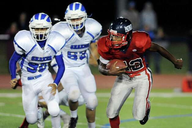 Schenectady's Jayquan Beckford, right, carries the ball during their football game against Shaker on Friday, Sept. 19, 2014, at Schenectady High in Schenectady, N.Y. (Cindy Schultz / Times Union) Photo: Cindy Schultz / 00028670A