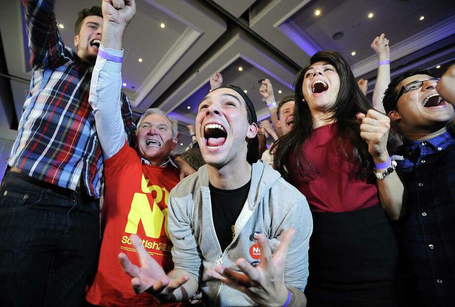 Pro-union supporters celebrate as Scottish indepen- dence referendum results are returned at a Better Together event in Glasgow, Scotland. Photo: Andy Buchanan / Getty Images / © Andy Buchanan 2014 All Rights Reserved.