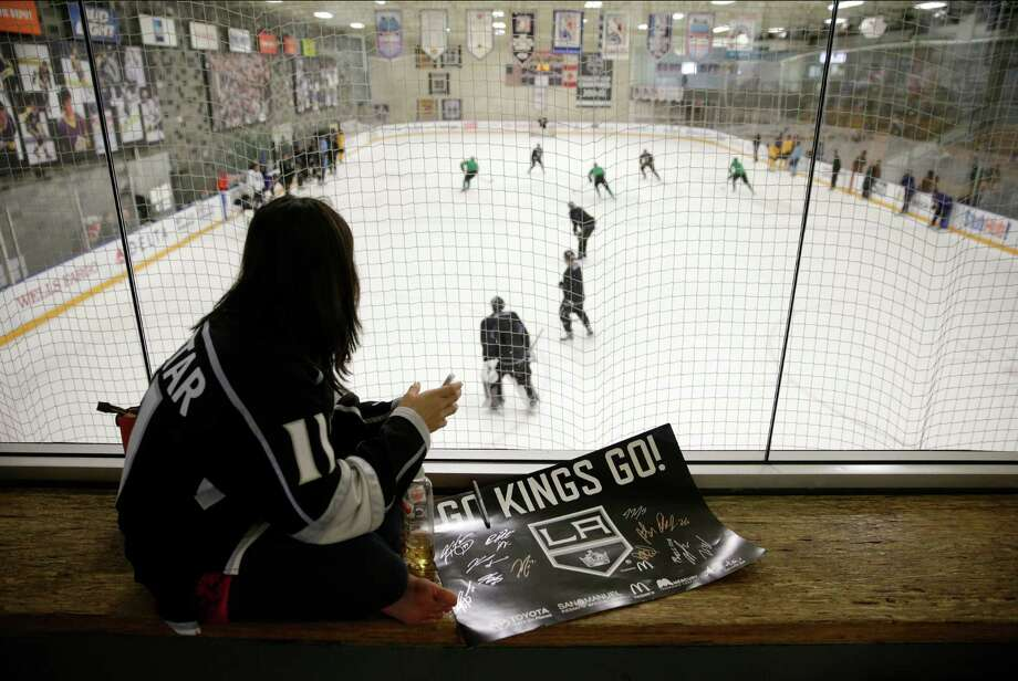 Los Angeles Kings fan Melissa Hom of Manhattan Beach, Calif., was on hand as the Stanley Cup champions opened training camp Friday. Photo: Jae C. Hong, STF / AP