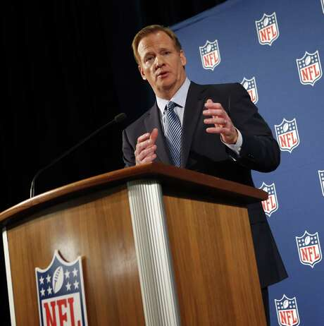 Commissioner Roger Goodell, speaking to reporters in New York, said he and NFL Players Association chief DeMaurice Smith will work with outside experts to evaluate league policies. Photo: Jason DeCrow / Associated Press / FR103966 AP