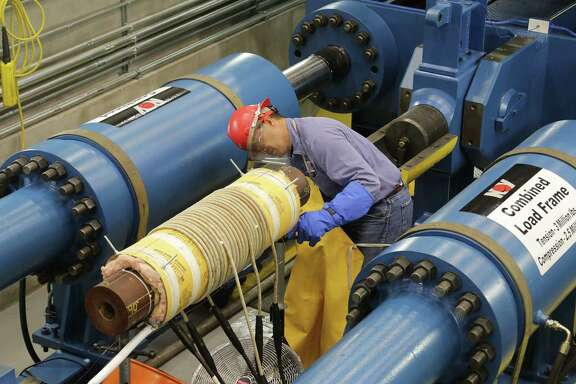 An employee checks machinery at NOV Grant Prideco's engineering technology center. It's part of National Oilwell Varco.