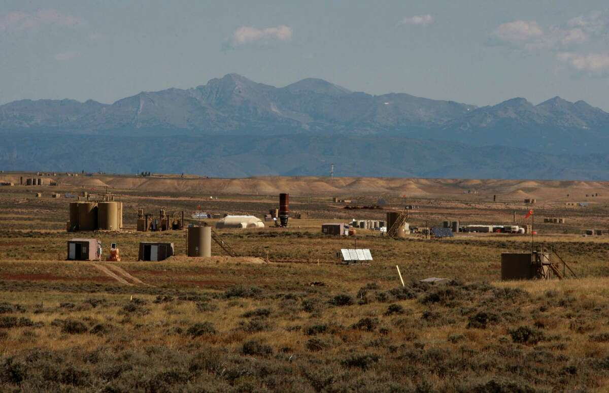 Natural gas wellhead huts, central delivery points and other infrastructure dot the Jonah Field on Monday, Sept. 8, 2014 near Pinedale, Wyo. Jonah Energy recently acquired Encana's natural gas assets in the area. (AP Photo/Casper Star-Tribune, Alan Rogers)