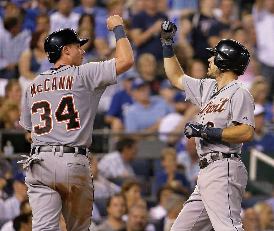 Detroit Tigers' Ian Kinsler, right, and James McCann (34) celebrate after Kinsler hit a two-run home run during the fifth inning of a baseball game against the Kansas City Royals on Friday, Sept. 19, 2014, in Kansas City, Mo. (AP Photo/Charlie Riedel) ORG XMIT: MOCR114 Photo: Charlie Riedel / AP