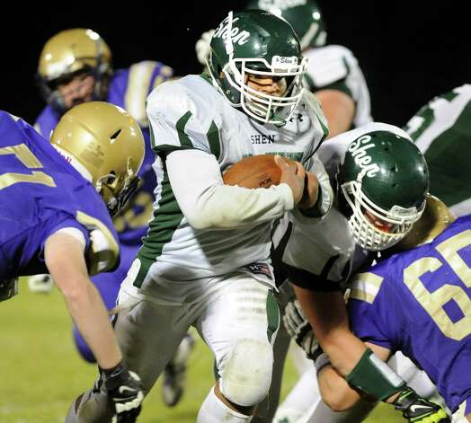 Shen's Oliver Robinson, center, plows through a hole during their football game against CBA on Friday, Sept. 19, 2014, at Christian Brothers Academy in Colonie, N.Y. (Cindy Schultz / Times Union) Photo: Cindy Schultz / 00028643A