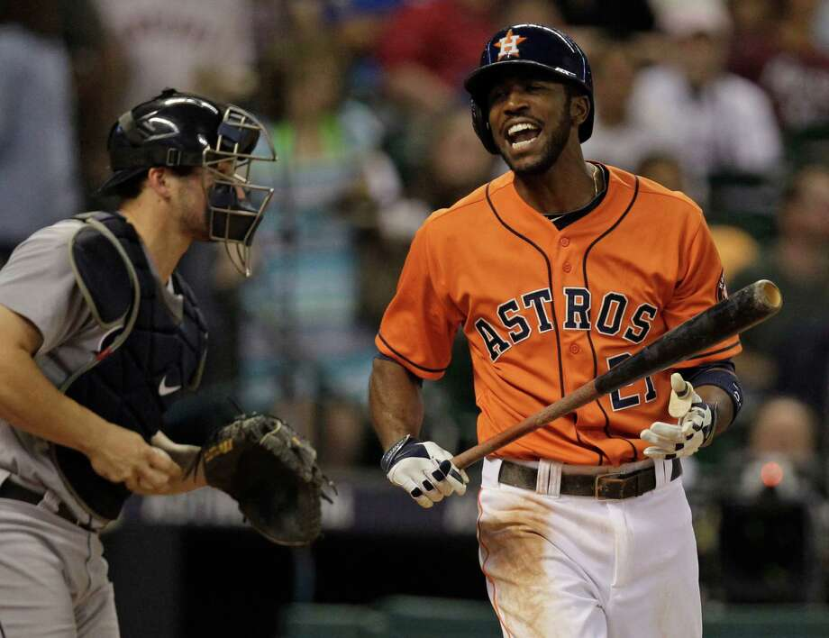 Striking out with the bases loaded in the third inning displeases Dexter Fowler. With 11 strikeouts Friday night against Mariners pitchers, the Astros have struck out 54 times during their four-game losing streak. Photo: Melissa Phillip, Staff / © 2014  Houston Chronicle