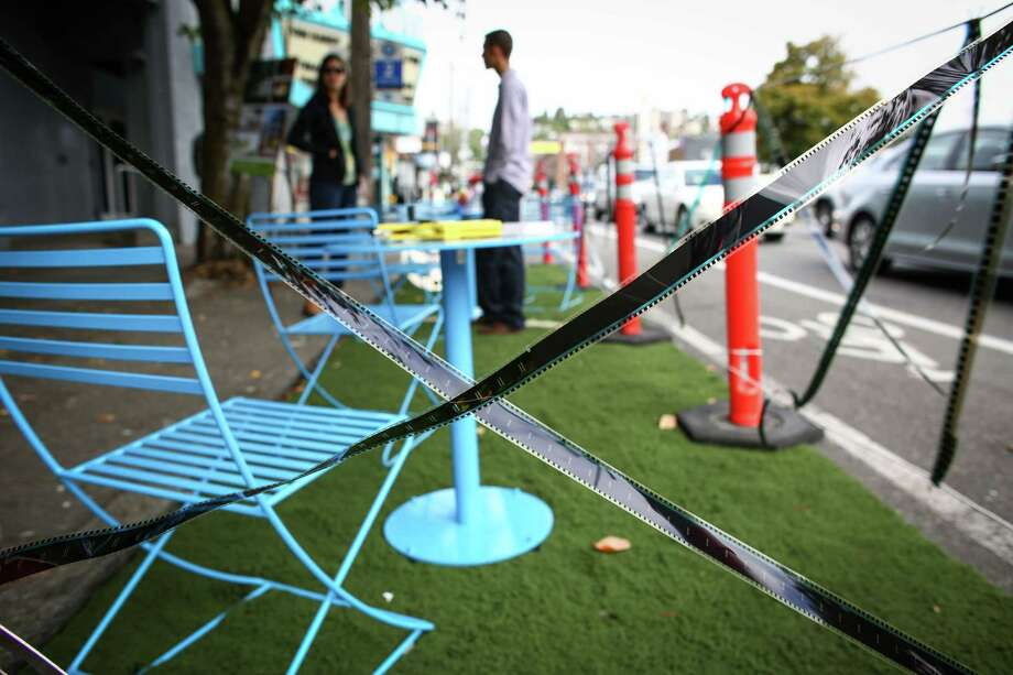 A parklet is mocked up in a space created by the Uptown Alliance and Via Architecture on Queen Anne Avenue North during PARK(ing) Day on Friday, September 19, 2014. PARK(ing) Day is an annual event that transforms parking spaces in to active community spaces. The Seattle Department of Transportation announced April 20 that more permanent parklets will hit Seattle streets in the coming year. Photo: JOSHUA TRUJILLO, SEATTLEPI.COM / SEATTLEPI.COM
