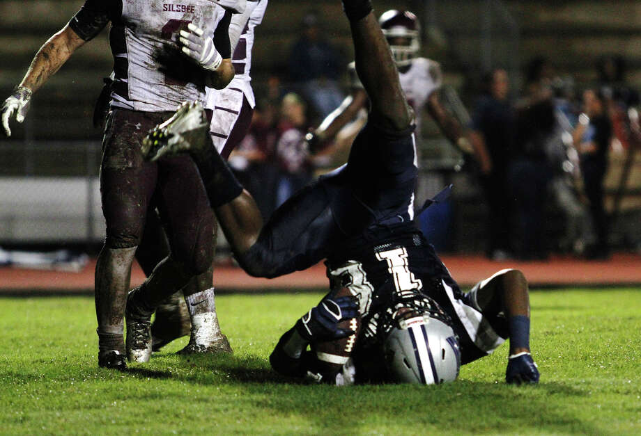 The Mustangs' Will Johnson, No. 18, rolls through a catch in the end zone, scoring a touch down against the Tigers during Friday night's game. The West Orange-Stark Mustangs hosted the Silsbee Tigers on Friday, Sept. 19, 2014. Photo taken Friday 9/19/14 Jake Daniels/@JakeD_in_SETX Photo: Jake Daniels / ©2014 The Beaumont Enterprise/Jake Daniels
