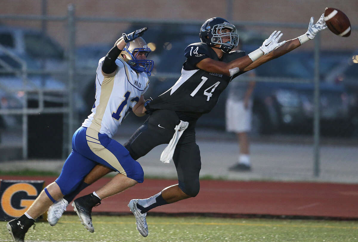 Eric Aldaco narrowly misses a touchdown pass for the Chargers ahead of Richard Comeaux as Boerne Champion hosts Alamo Heights at Boerne High School on September 19, 2014.