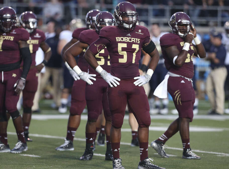 Texas State defensive end Karee Berry (57), a Smithson Valley product, had six tackles in his first start in the 35-21 Navy loss. Photo: Tom Reel / San Antonio Express-News