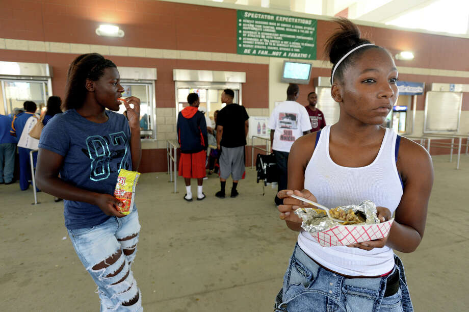 Central High School student Anteyah Joubert, 16, takes in the game action from the concourse while she and friend Chasity Ozen, 16, make a stop at the concession stands for a snack during Saturday's Lone Star Classic games. Photo taken Saturday, September 13, 2014 Kim Brent/@kimbpix Photo: KIM BRENT / Beaumont Enterprise