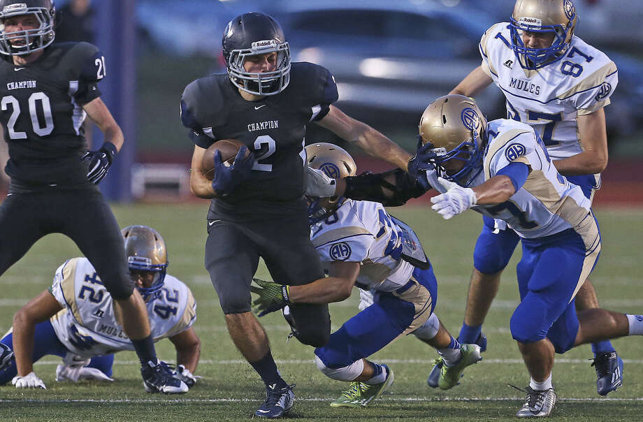 Cort Cowart (2), trying to avoid Alamo Heights defenders, had 158 receiving yards and three TDs for Boerne Champion. Photo: Tom Reel / San Antonio Express-News