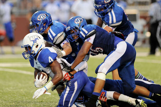 The West Brook Bruins take on the Taylor Mustangs at the Carroll Thomas Stadium Friday, Sept 19, 2014. Photo by Drew Loker. Photo: Drew Loker / ©2014. www.DrewLoker.com