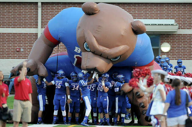 The West Brook Bruins get ready to take the field against the Taylor Mustangs at the Carroll Thomas Stadium Friday, Sept 19, 2014. Photo by Drew Loker. Photo: Drew Loker / ©2014. www.DrewLoker.com