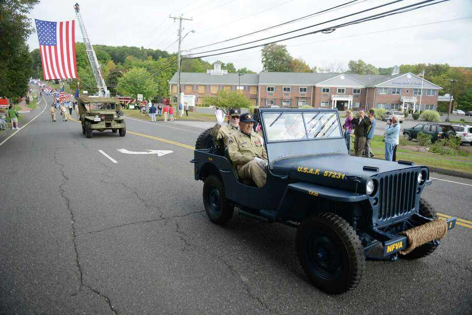 "Photos from the New Fairfield Day Parade and Flag Presentation Ceremony in New Fairfield, Conn. Saturday, Sept. 20, 2014.  The day began with a parade followed by a ceremony to remember deceased New Fairfield residents Chris Blackwell and T.J. Lobraico, Jr.  Blackwell was a New York City firefigther who died on September 11, 2001 and Lobraico was an Air National Guard Staff Sergeant who was killed in Afghanistan on Sept. 5, 2013.  The Town of New Fairfield is remembering them with the street name ""Patriots Way."" Photo: Tyler Sizemore / The News-Times"