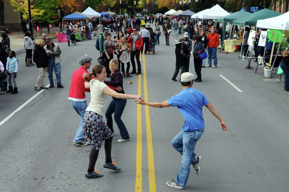Swing dancers at Upper Madison Street Fair in Albany in 2011. This year's event takes place Sunday, Sept. 21, 2014. (Times Union Archive) ORG XMIT: MER2014092013160180 Photo: Philip Kamrass / 00014837A