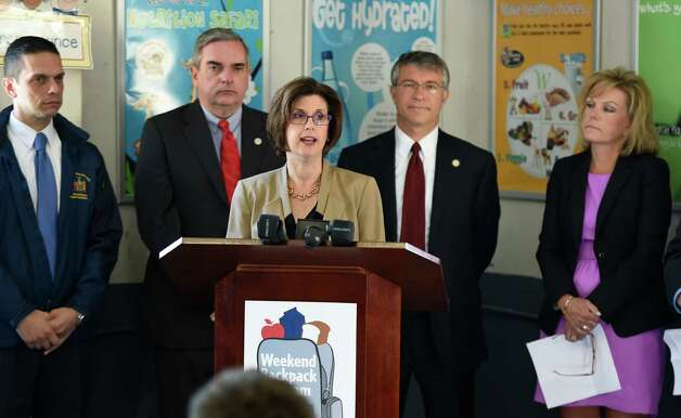 "MVP Health Care CEO Denise Gonick leads a group of local politicians and school officials in announcing the Weekend Backpack Program at the Pleasant Valley School Wednesday morning Sept. 17, 2014 in Schenectady, N.Y.  The program is designed address the widespread issue of ""food insecure"" students by giving these families food that will last over the weekend while school is closed.       (Skip Dickstein/Times Union) Photo: SKIP DICKSTEIN / 00028657A"