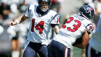 Houston Texans quarterback Ryan Fitzpatrick, left, hands off the ball to running back Arian Foster in the first quarter of an NFL football game against the Oakland Raiders Sunday, Sept. 14, 2014, in Oakland, Calif. (AP Photo/Beck Diefenbach)