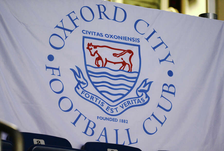 A sign for the Oxford City FC hands in Ford Arena Saturday morning. The Oxford City Football Club held tryouts at Ford Park on Saturday, Sept. 20, 2014. Thomas Anthony Guerriero, president of the club, said they want to attract local talent in addition to international players. The Beaumont team will be the most recent expansion of the club. Photo taken Saturday 9/20/14 Jake Daniels/@JakeD_in_SETX Photo: Jake Daniels / ©2014 The Beaumont Enterprise/Jake Daniels