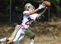 Bethel's Giovanni Luongo (23) extends his arms attempting a catch against Notre Dame Fairfield defender Andrew Chimento in Bethel's 66-36 win over Notre Dame Fairfield at Notre Dame Catholic High School in Fairfield, Conn. Saturday, Sept. 20, 2014.