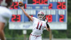 Bethel quarterback Jared Piatnik (11) throws a pass to the endzone in Bethel's 66-36 win over Notre Dame Fairfield at Notre Dame Catholic High School in Fairfield, Conn. Saturday, Sept. 20, 2014.