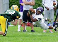 Westhill's Nasser Louis makes a diving catch during Saturday's game at Trinity Catholic High School in Stamford, Conn., on September 20, 2014.