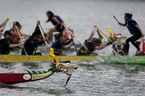 Dragon boats compete in the 13th race at the San Francisco International Dragon Boat Festival on Treasure Island in San Francisco, Calif. on Saturday, Sept. 20, 2014.