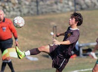 Brunswick's Nate Stuart, left, advances the ball during the boys high school soccer match between Brunswick School and Deerfield Academy at Brunswick in Greenwich, Conn., Saturday afternoon, Sept. 20, 2014. Deerfield defeated Brunswick, 1-0.