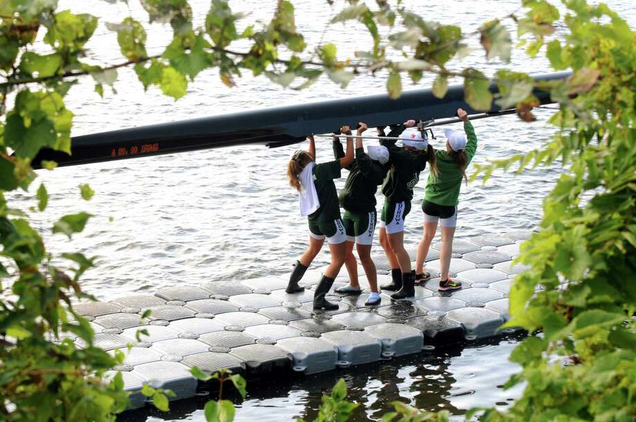 The Shenedehowa High School girl's crew team wrestle their boat out of the Hudson River during the 28th Head of the Hudson Regatta on Saturday Sept. 20, 2014 in Albany, N.Y.  (Michael P. Farrell/Times Union) Photo: Michael P. Farrell / 00028333A
