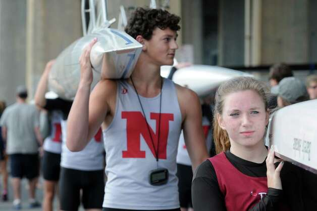 Niskayuna's Kees Vandenberg, center, and Burnt Hills Samantha Kelly get in the lineup with their double bouts during the 28th Head of the Hudson Regatta on Saturday Sept. 20, 2014 in Albany, N.Y.  (Michael P. Farrell/Times Union) Photo: Michael P. Farrell / 00028333A