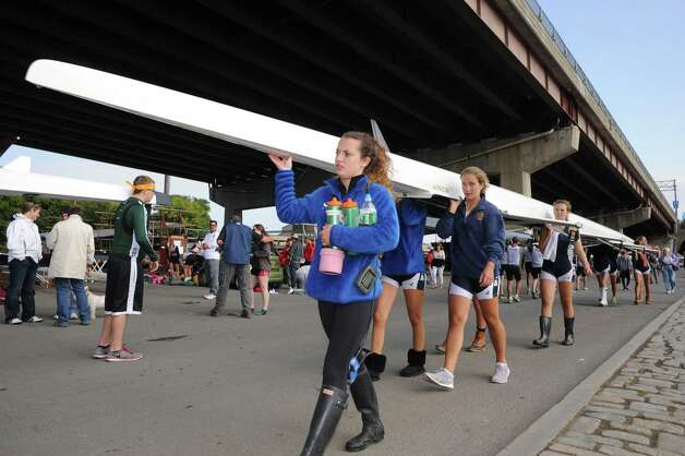 The Saratoga girl's crew team transfers their boat after being on the water during the 28th Head of the Hudson Regatta on Saturday Sept. 20, 2014 in Albany, N.Y.  (Michael P. Farrell/Times Union) Photo: Michael P. Farrell / 00028333A