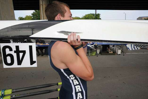 Saratoga's Liam Millens waits to enter the water with his doubles craft during the 28th Head of the Hudson Regatta on Saturday Sept. 20, 2014 in Albany, N.Y.  (Michael P. Farrell/Times Union) Photo: Michael P. Farrell / 00028333A