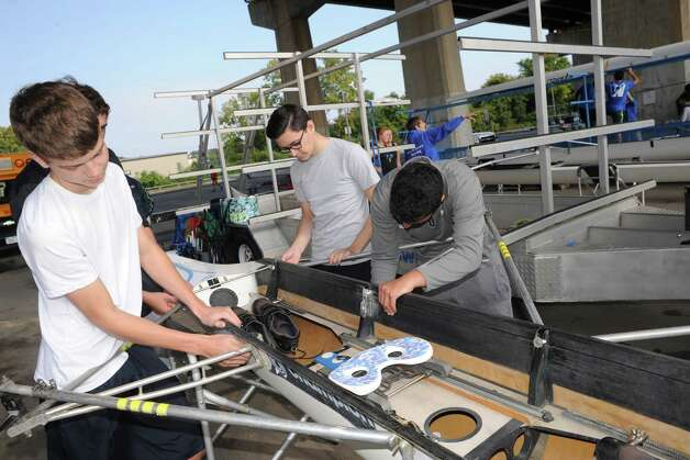 Left, to right, Michael Prappulos, Euan Walker, Joey Illuzzi and Craig Rosen of the North Jersey crew team work on their quad boat during the 28th Head of the Hudson Regatta on Saturday Sept. 20, 2014 in Albany, N.Y.  (Michael P. Farrell/Times Union) Photo: Michael P. Farrell / 00028333A