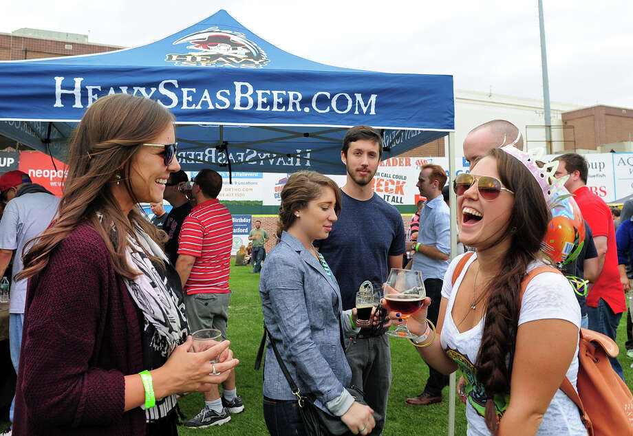 Catina Cricco, of Norwalk, at right, celebrates her birthday with Caitlin Whynall, of Killingworth, at left, and some of her other friends, during the Harbor Brew Fest at the Bluefish Stadium at Harbor Yard in Bridgeport, Conn., on Saturday Sept. 20, 2014. The festival featured international, domestic, and local beers as well as bands and Connecticut's most popular food trucks. Photo: Christian Abraham / Connecticut Post