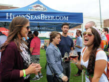 Catina Cricco, of Norwalk, at right, celebrates her birthday with Caitlin Whynall, of Killingworth, at left, and some of her other friends, during the Harbor Brew Fest at the Bluefish Stadium at Harbor Yard in Bridgeport, Conn., on Saturday Sept. 20, 2014. The festival featured international, domestic, and local beers as well as bands and Connecticut's most popular food trucks.