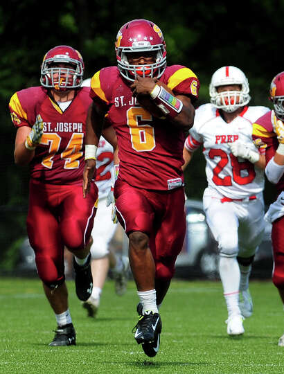 St. Joseph's Mufasha Abdul Basir breaks away to take the ball to the endzone for a touchdown, during