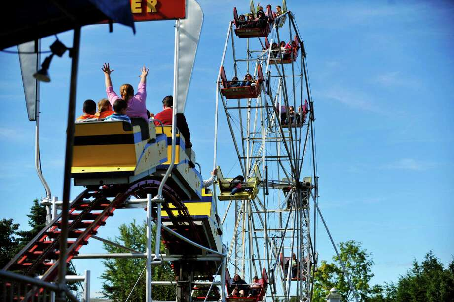 Adults and children take rides on the roller coaster and the ferris wheel during the final day of business at Hoffman's Playland, on Sunday, Sept. 14, 2014, in Latham, N.Y.  The business first opened in 1952.  (Paul Buckowski / Times Union) Photo: Paul Buckowski / 00028503A