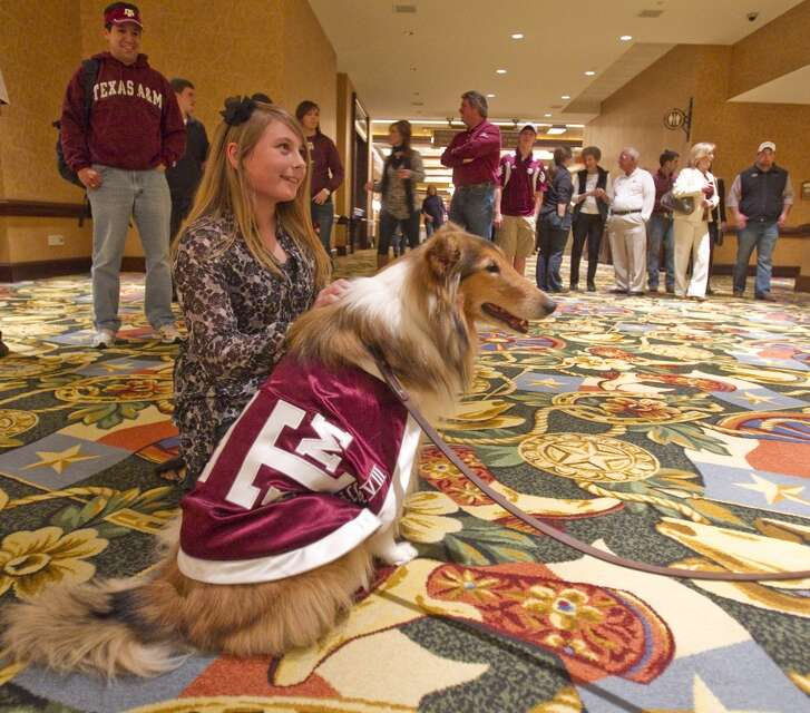 Brittnay Scott, 11, of College Station, poses for a picture with the Texas A&M mascot Reveille VIII during a 12th Man Foundation party Thursday, Jan. 6, 2011, in the Gaylord Texan Resort & Convention Center  in Grapevine. Texas A&M is set to play LSU in the ATT Cotton Bowl today. ( Nick de la Torre / Houston Chronicle )