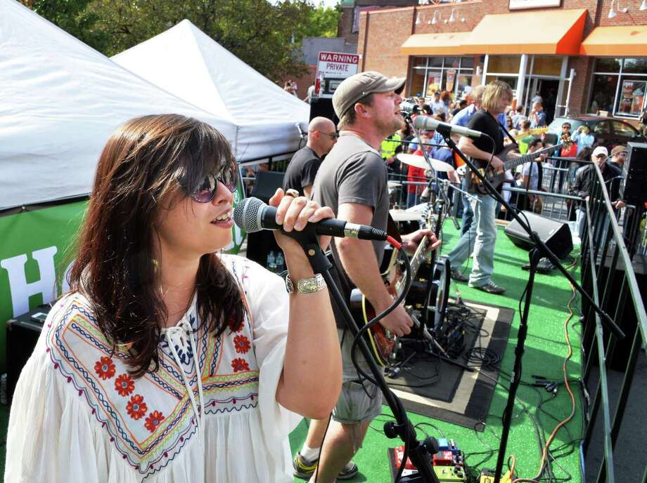 Melli Rose, left, performs with Chris Dukes, center, and his band at this year's LarkFest Saturday Sept. 20, 2014, in Albany, NY.  (John Carl D'Annibale / Times Union) Photo: John Carl D'Annibale / 00028421A
