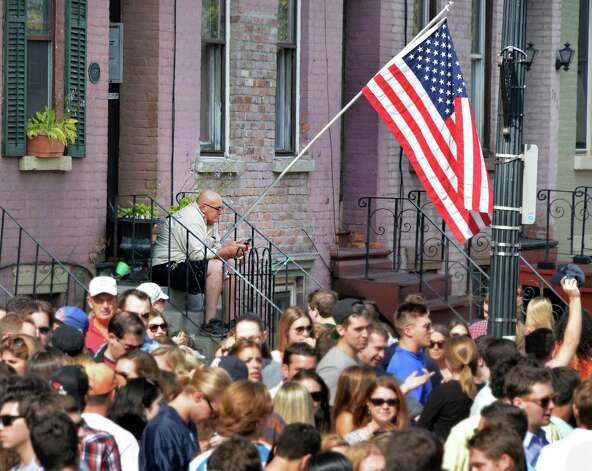 Lark Street resident RA DePrimasits on his stoop as crowds fill Lark Street at this year's LarkFest Saturday Sept. 20, 2014, in Albany, NY.  (John Carl D'Annibale / Times Union) Photo: John Carl D'Annibale / 00028421A