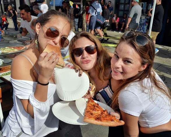 UAlbany students Danae Samgiogio, left, Mina Hoblitz and  Ashley Corby sample pizza at this year's LarkFest street festival Saturday Sept. 20, 2014, in Albany, NY.  (John Carl D'Annibale / Times Union) Photo: John Carl D'Annibale / 00028421A