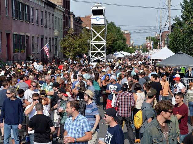 A police tower looms over the crowds at this year's LarkFest street festival Saturday Sept. 20, 2014, in Albany, NY.  (John Carl D'Annibale / Times Union) Photo: John Carl D'Annibale / 00028421A