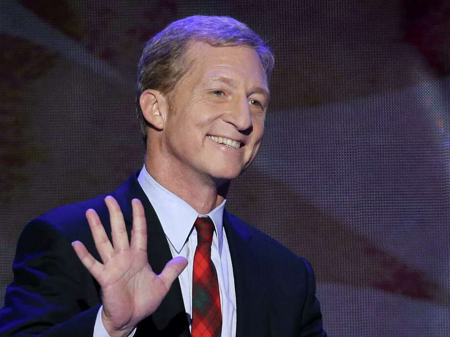 FILE - In this Sept. 5, 2012 file photo, Tom Steyer waves as he walks to the podium to address the Democratic National Convention in Charlotte, N.C.    Steyer continued to funnel cash from his personal fortune to his pro-environment super PAC, NextGen Climate Action. Steyer in August wrote his federal committee a $15 million check as it ramps up a political operations to help candidates who pledge to back legislation fighting combat climate change.  (AP Photo/J. Scott Applewhite, File) Photo: J. Scott Applewhite, STF / AP